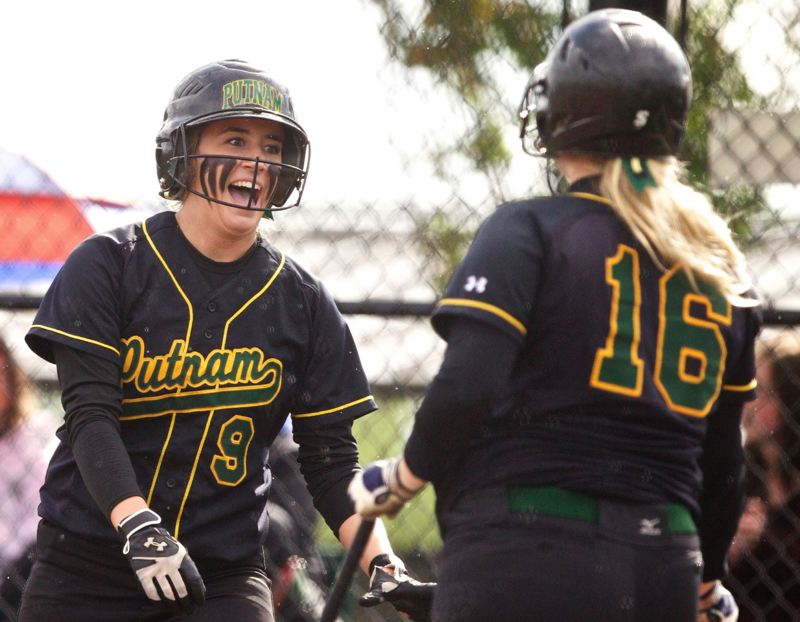 by: JAIME VALDEZ - Putnam senior Taylor Balfour (9) is all smiles as she is greeted by Maggie Waymire after scoring a run in last weeks 3-1 state playoff win over Churchill. Balfour went 2-for-2 in the game, with a triple.