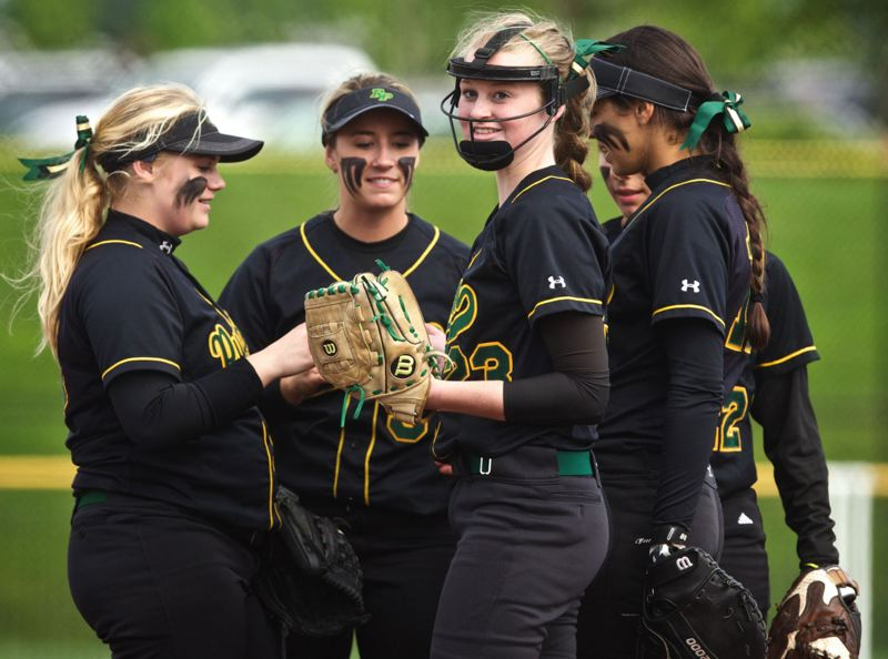 by: JAIME VALDEZ - Sarah Abramson (with facemask) was at the top of her game on May 28, as she threw a 3-hitter in a 3-1 win over Churchill. The Kingsmen freshman right-hander had 12 strikeouts and Churchills only run was unearned. Pictured with Abramson during the Churchill game are (from left) Maggie Waymire, Taylor Balfour, Mariah Oliver and Brooke Snyder.