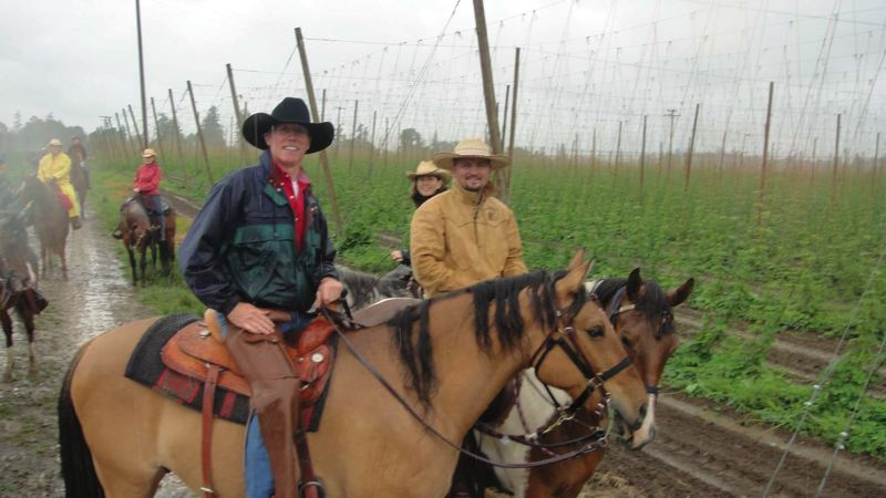 by: COURTESY OF BOB HEYE - Bob Heye of Happy Valley (in the black hat) rides in a damp St. Paul Rodeo Trail Ride in 2010. Involvement in St. Paul Rodeo activities is an annual thing for Heye, a KATU (2) reporter.