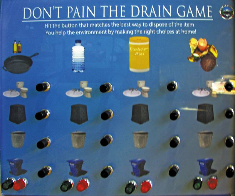 by: OUTLOOK PHOTO: LISA K. ANDERSON - The 'Don't pain the drain' game helps educate the public about proper waste disposal.