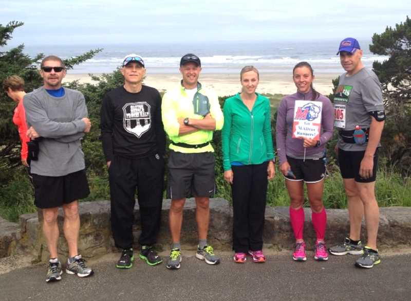 by: JAMIE HURD PHOTO - MADras runners Rick Moon, Mark Schongalla, Job Powell, Sara Hertel, Jamie Hurd and Steven Webb competed in the Newport Marathon last weekend.