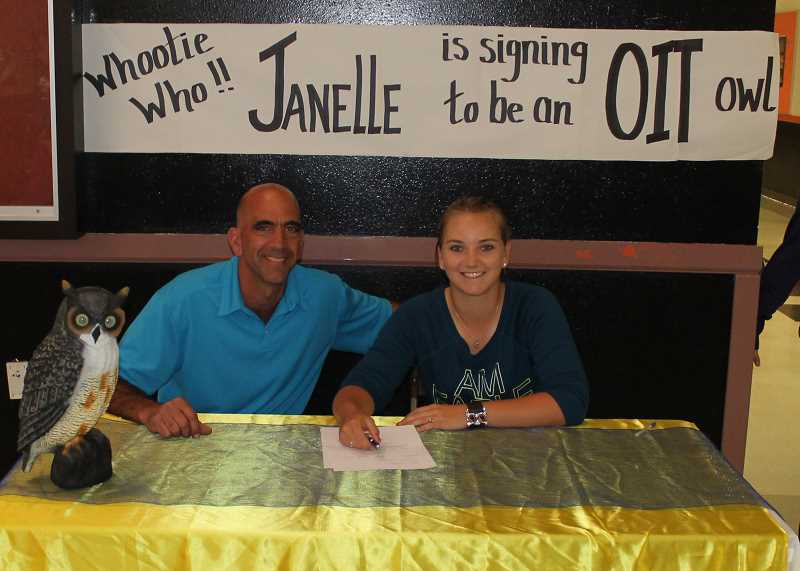 by: JIM BESEDA/MOLALLA PIONEER - Molalla's Janelle Ferlan, right, sits alongside Indians' golf coach JD Clarizio after signing a letter of intent to play college golf for Oregon Institute of Technology in Klamath Falls.