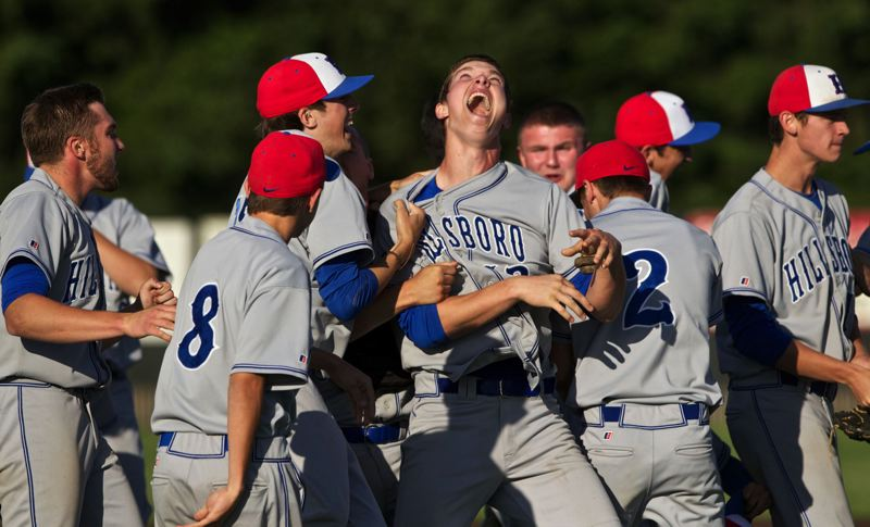 by: HILLSBORO TRIBUNE PHOTO: JAIME VALDEZ - Hillsboro pitcher Chase Kaplan (12) celebrates after the Spartans 2-1 win over Clackamas in the 6A baseball quarterfinals at Clackamas High School.