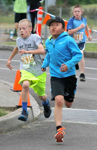 by: SPOKESMAN PHOTOS: J. BRIAN MONIHAN - Runners of all sizes took on the 5K event at Tonkin For the Love of Schools Challenge.