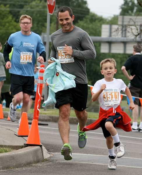 by: SPOKESMAN PHOTO: J. BRIAN MONIHAN - The 5K gets underway during Tonkin For the Love of Schools Challenge.