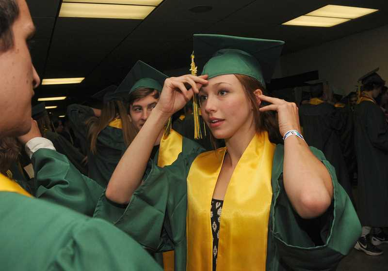 by: TIDINGS PHOTO: VERN UYETAKE - Savannah Hartfield makes some final adjustment to her cap.