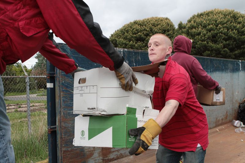 by: DAVID F. ASHTON - Many hands make the work light at the BDNA Clean-Up.