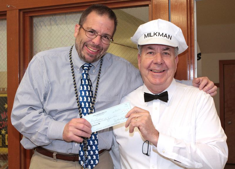 by: DAVID F. ASHTON - Llewellyn Elementary School Principal Joe Galati receives a check for the Llewellyn Foundation from Scott McDonald, right, of Local Farmers Delivery.
