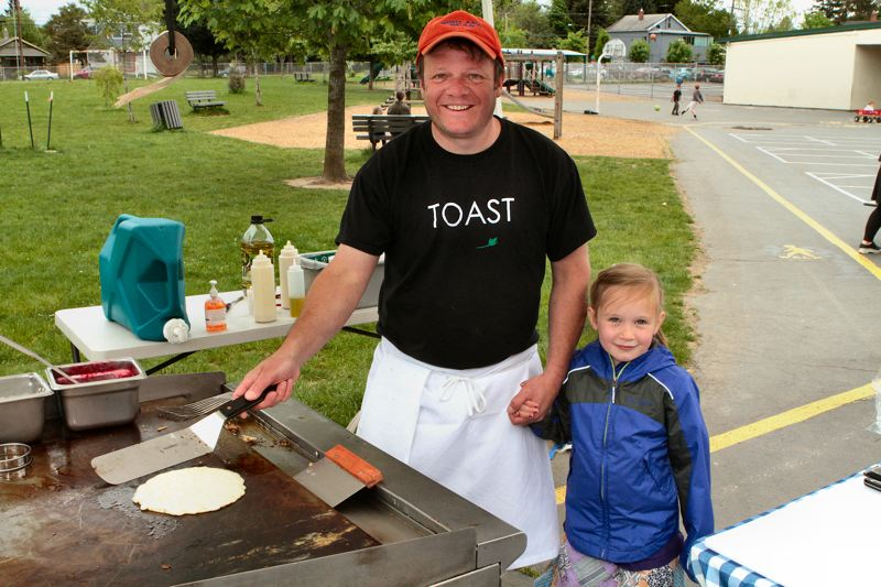 by: DAVID F. ASHTON - Donald Kotler of Toast restaurant on S.E. 52nd gets moral support from his daughter Gretchen - a Lewis student -- at the grill, as he prepares pancakes.