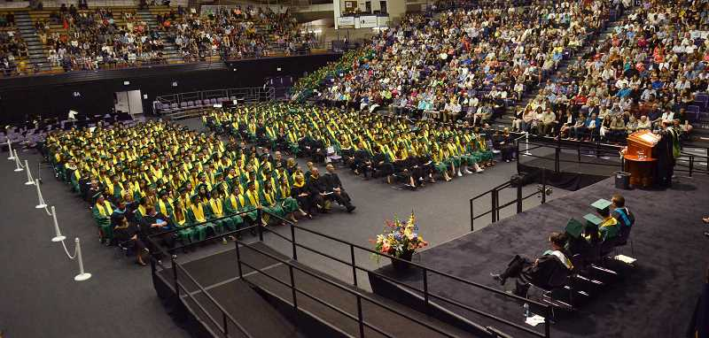 by: TIDINGS PHOTO: VERN UYETAKE - The graduates listen to the remarks of Superintendent Bill Rhoades.