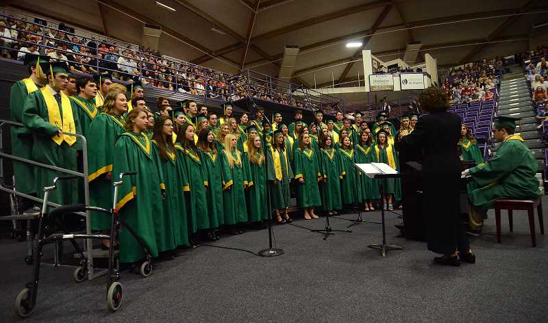 by: TIDINGS PHOTO: VERN UYETAKE - The WLHS symphonic choir performs a moving rendition of 'I Was Here.'