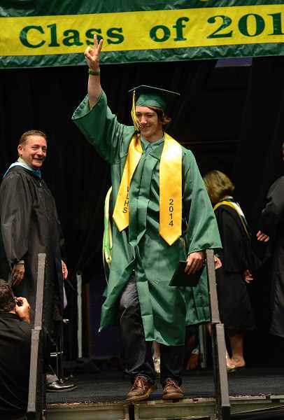 by: TIDINGS PHOTO: VERN UYETAKE - Ian Harris celebrates after receiving his diploma.