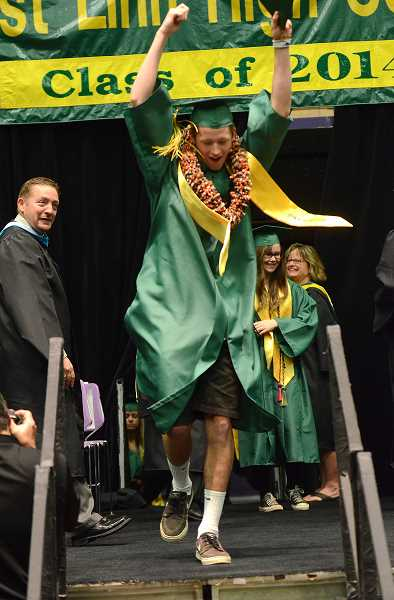 by: TIDINGS PHOTO: VERN UYETAKE - Ryan Lonsway does a quick dance after getting his diploma.