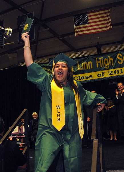by: TIDINGS PHOTO: VERN UYETAKE - Alyssa Zuniga-Moss may be the last graduate to receive a diploma but she is happy to keep the celebration going.