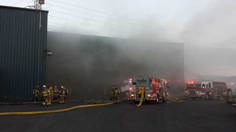 by: COURTESY OF TVF&R - TVF&R crews extinguish a fire at the Pride Recycling Company building on Tualatin-Sherwood Road Tuesday evening.