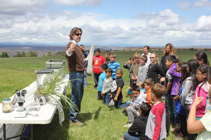by: SUSAN MATHENY/MADRAS PIONEER - A tour of Sullivan's Pond taught students about aquatic life.