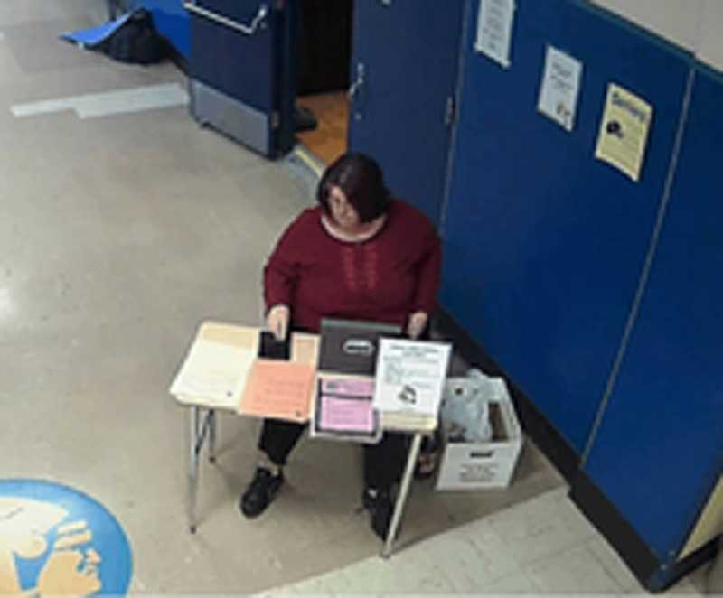 by: COURTESY PHOTO: WASHINGTON COUNTY SHERIFFS OFFICE - A surveillance video allegedly shows Banks parent and longtime volunteer Cindy Schorn pocketing money she collected in entry fees in the hallway outside the Banks High School gym earlier this year.