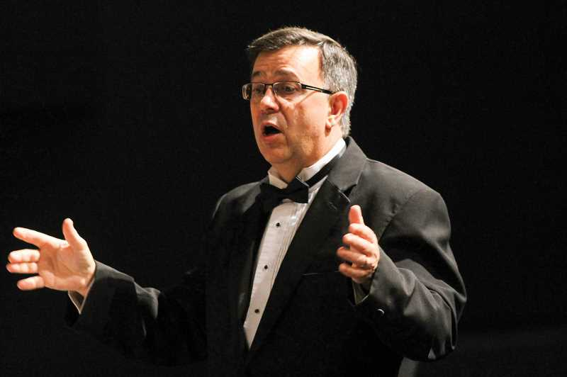 by: NEWS-TIMES PHOTOS: JOHN SCHRAG - Leonard Ostwalt picked up his baton for one final concert last Wednesday at Forest Grove High School.