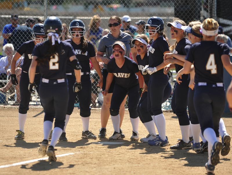 by: NEWS-TIMES PHOTO: ZACK PALMER - Banks sophomore MaKenna Partain (2) is greeted at home plate by her teammates after hitting a two-run home run in the fifth inning of Tuesday's Class 4A state semifinal against Henley.