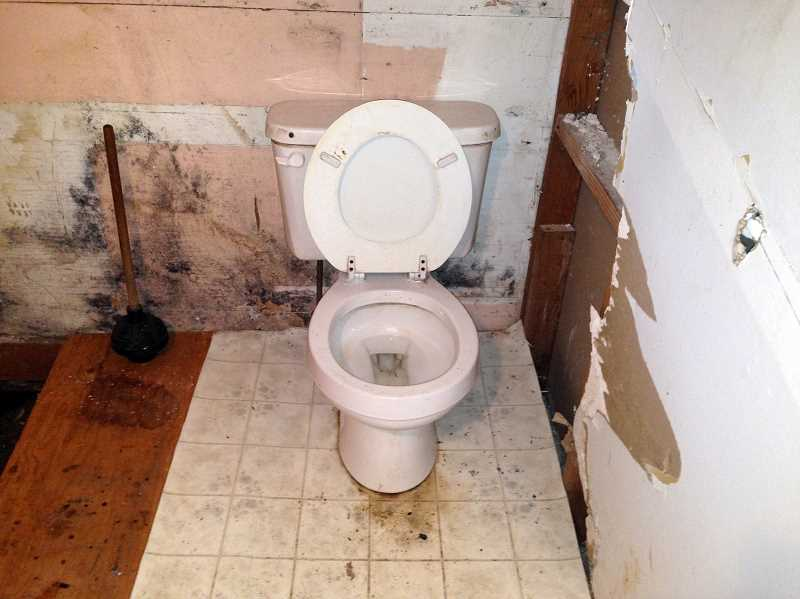 by: CONTRIBUTED PHOTO: R. EVERETT MEADOWS, AN ATTORNEY WITH WILES LAW GROUP, LLC - This Jan. 10 photo of a bathroom in the main house also was used as proof of the premises being uninhabitable in Spencer's countersuit against McNamee.