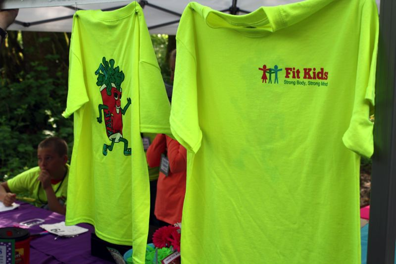 by: POST PHOTO: KYLIE WRAY - T-shirts featuring the Fit Kids mascot, a jogging kale smoothie, were available to buy at the event.