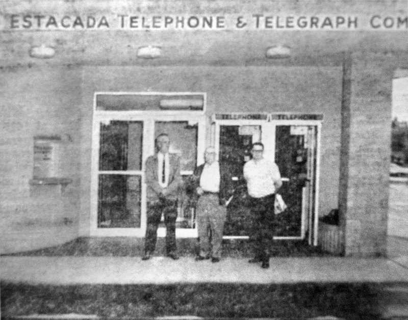 by: ARCHIVE PHOTO - Safety Representative J.A. Jim Jump of the States Accident Prevention Division (from left), President of Estacada Telephone & Telegraph Co. Floyd Day and Assistant Manager Duane Day are pictured in front of the company in 1964.