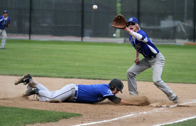 by: TIMES PHOTO: JONATHAN HOUSE - Valley Catholic's Jakob Pruitt slides safely into first against Amity.