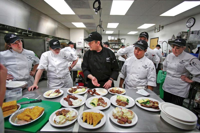 by: TRIBUNE PHOTOS: JONATHAN HOUSE - Oregon Culinary Institute instructor Dan Brophy critiques the performance of his students during a breakfast Fire Drill.