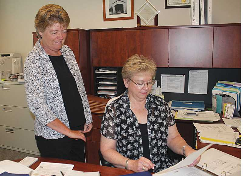 by: HOLLY M. GILL - In the absence of the county treasurer, Kathie Rohde, county finance director (left) and Kathy Marston, county clerk, have taken over the duties of the office, along with Debbie Palmer, not pictured. Treasurer Deena Goss is on administrative leave, pending the results of an investigation.