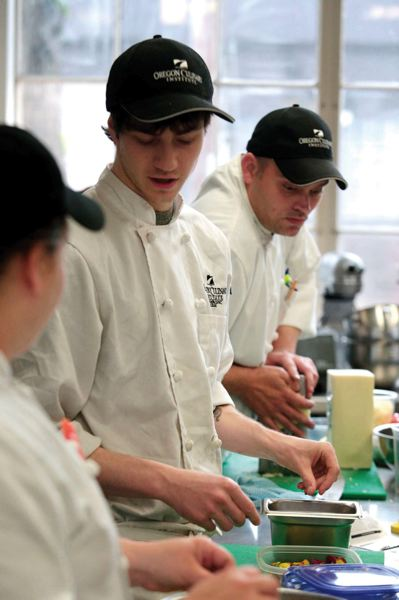 by: TRIBUNE PHOTOS: JONATHAN HOUSE - Students prepare a typical lunch meal during class at OCI, which has developed solid chefs for restaurants around Portland.