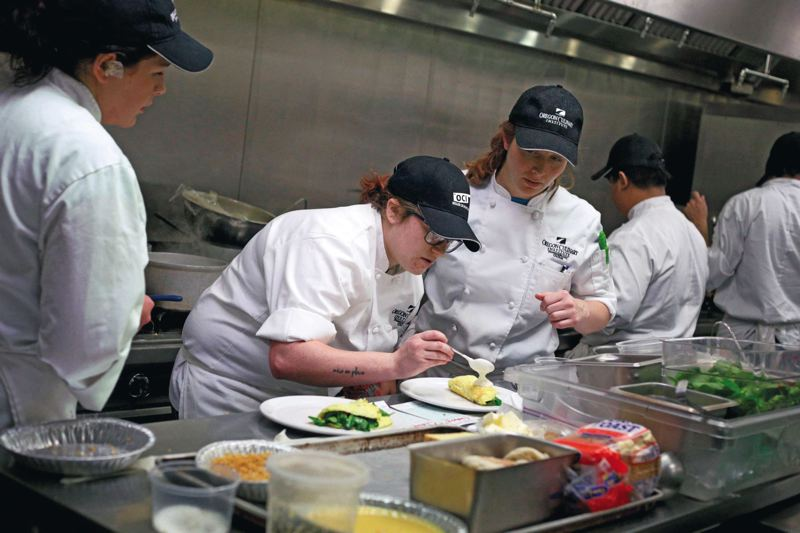 by: TRIBUNE PHOTOS: JONATHAN HOUSE - Oregon Culinary Institute students Chelsie Reeves and Natasha Dison prepare a breakfast during a recent class at the acclaimed school.