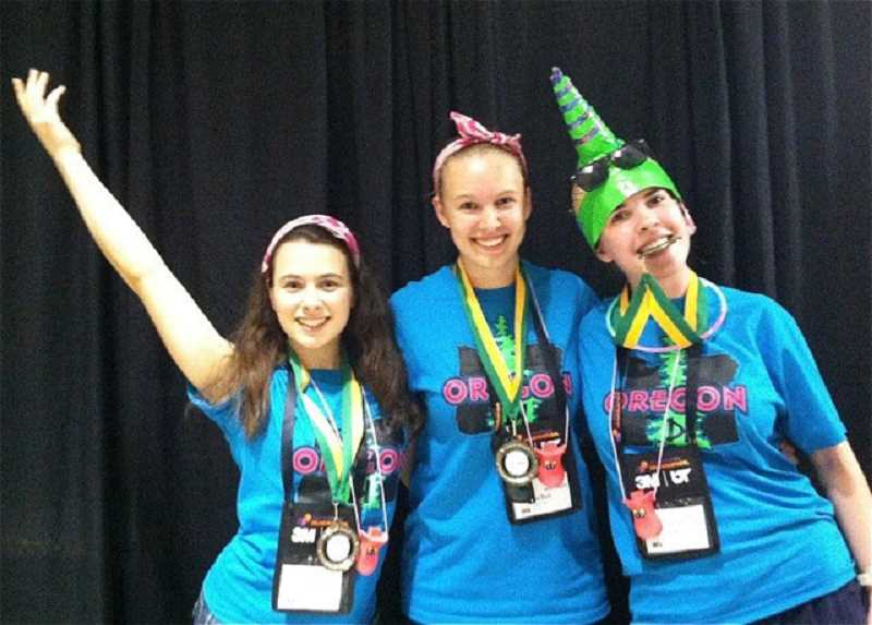 by: SUBMITTED PHOTO - Magical MoonFoxes Elise Kronquist, Rachel Rise and Alena Madin took first place in their instant challenge at the Destination Imagination Global Finals.
