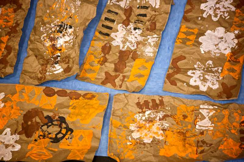 by: TIMES PHOTO: JAIME VALDEZ - Tapa cloths made on brown paper bags were just one of the projects students at McKay Elementary School made during Beaverton Education Foundation's Culture Week.