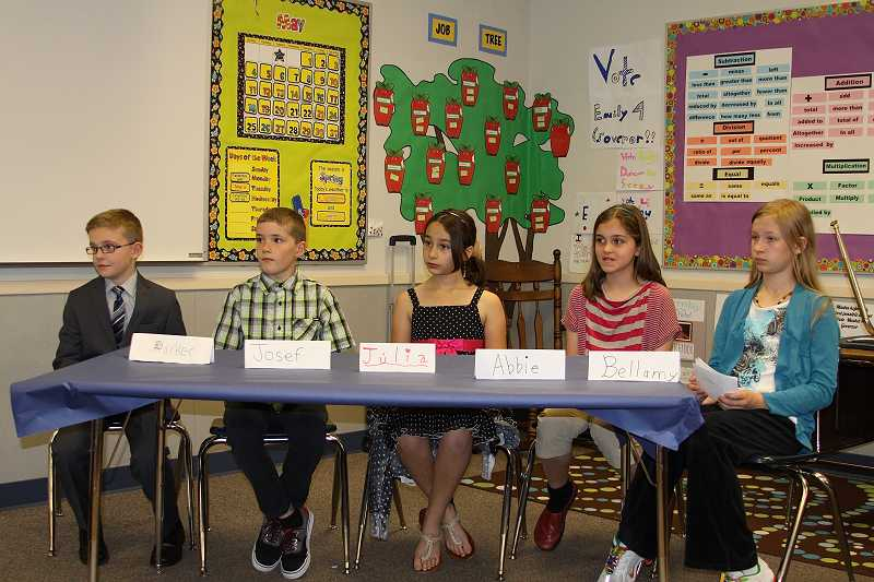 by: CONTRIBUTED PHOTO: MARLA KOPESEC - Sexton Mountain Elementary School fifth-graders, from left, Parker Arbuthnot, Josef Daniels, Julia VonGersdorff, Abbie Payne and Bellamy Kopesec, listen to judges at 'We the People,' a forum based on the U.S. Constitution held at the school on Wednesday, May 28.