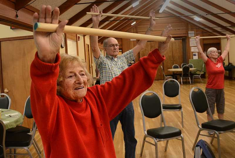 by: REVIEW PHOTO: VERN UYETAKE - National Fitness Day was a big hit at the Lake Oswego Adult Community Center. Shaping up here are Kay Kerr, in front, Larry Brown and Karen Brown.