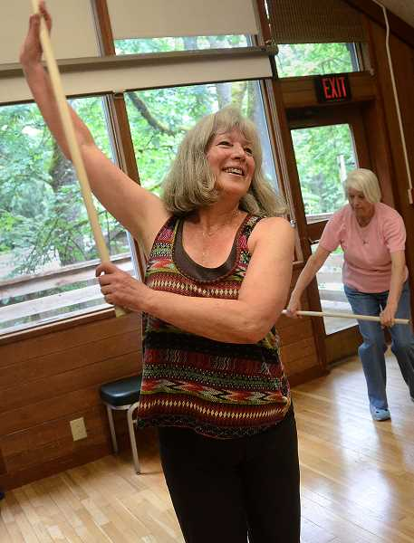 by: REVIEW PHOTO: VERN UYETAKE - Nancy Bantz was all smiles and grace as she led senior citizens through some fun aerobic exercises. Bantz, a former ACC director, has been getting seniors in shape for many years.