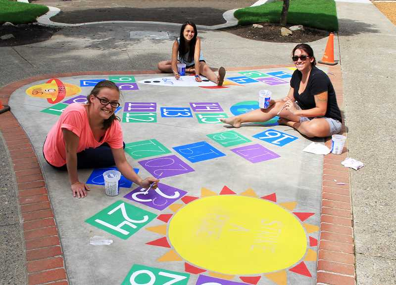 by: REVIEW PHOTO: CLIFF NEWELL - It will be a day of pride and fun on June 14  when the Youth Action Council unveils the new hopscotch court at George Rogers. From left are Elizabeth Hill, Emily Liu and Cydny Fletcher.