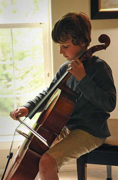 by: REVIEW, TIDINGS PHOTO: VERN UYETAKE - The Snowman Foundation thought so much of Preston Barlow that the organization gave him a cello. He has big plans for a musical future.