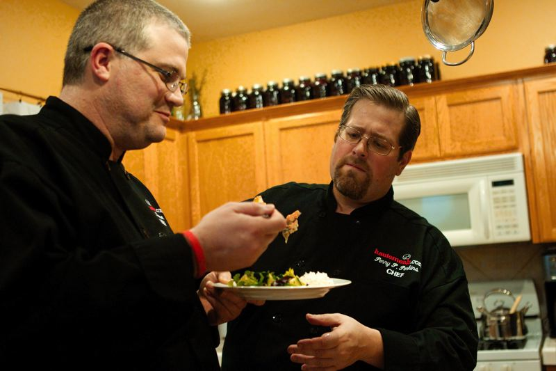by: FILE PHOTO - Chefs Chris Renner and Perry Perkins of Hautemealz put great efforts into volunteering, and will be traveling to the Philippines in January to assist volunteers at a feeding center.
