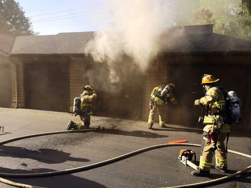 by: TVF&R - Tualatin Valley Fire & Rescue crews battled a garage fire in Tigard, on Thursday morning.