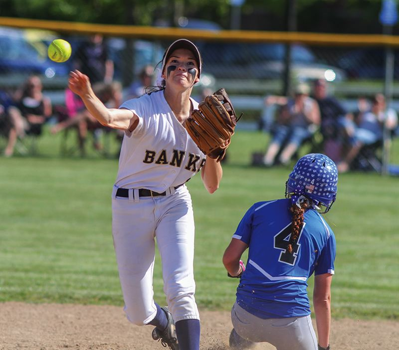 by: NEWS-TIMES PHOTO: CHASE ALLGOOD - Banks sophomore shortstop MaKenna Partain tries to turn a double play during Friday's game against Mazama in the quarterfinals of the Class 4A softball state playoffs.