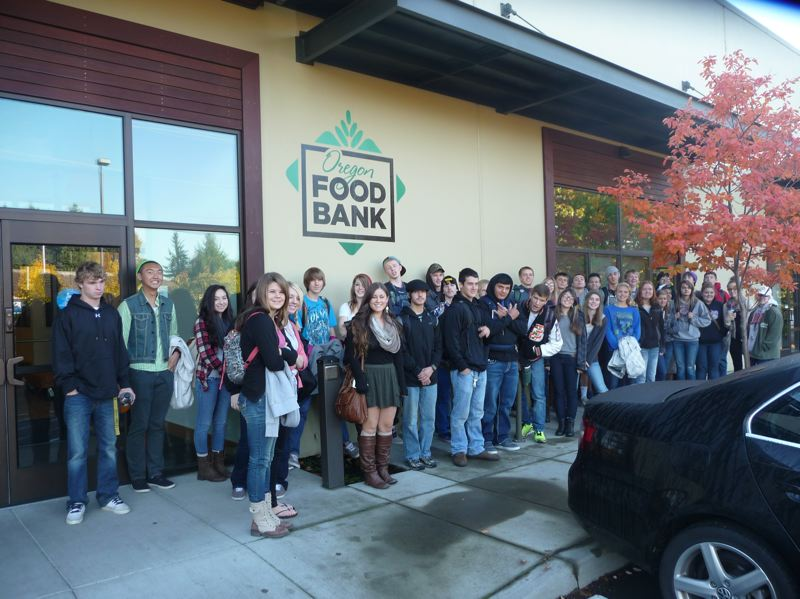 by: SUBMITTED PHOTO - Scappoose High School students visit the Oregon Food Bank as part of their Community 101 class. The class recently awarded grants to a number of local organizations.