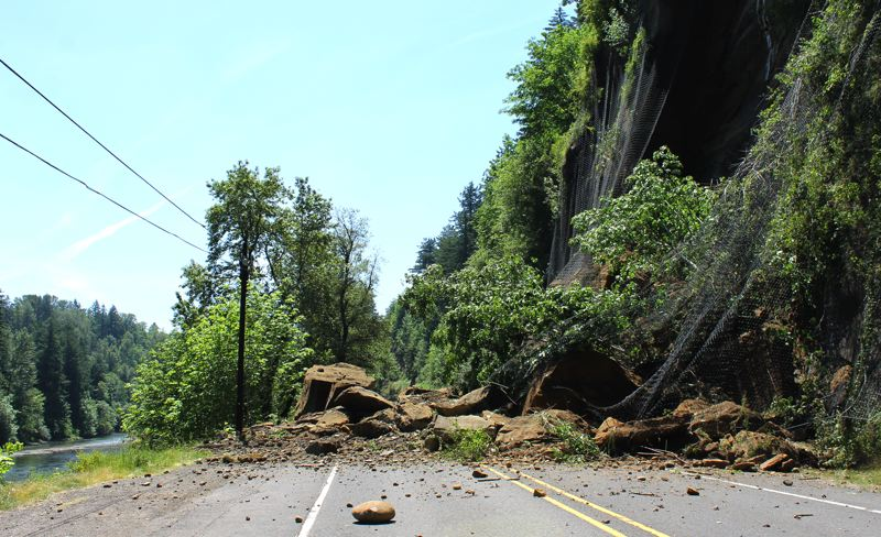 by: OUTLOOK PHOTO: CARI HACHMANN - More than 100 truckloads of rock spilled onto the highway when the hillside broke loose at about 11:30 a.m. Thursday.