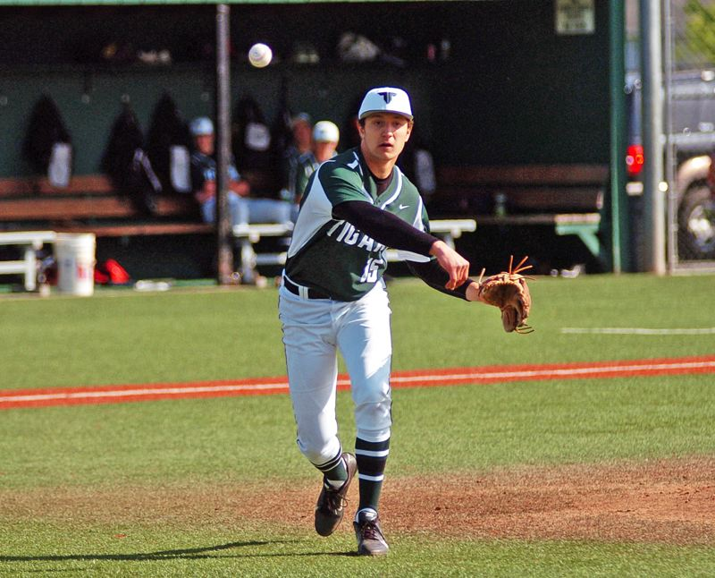 by: DAN BROOD - PLAYOFF WINNER -- Tigard High School senior Nick Duron, shown here in a game played earlier in the season, was the starting pitcher for the Tigers in their postseason win over Beaverton.