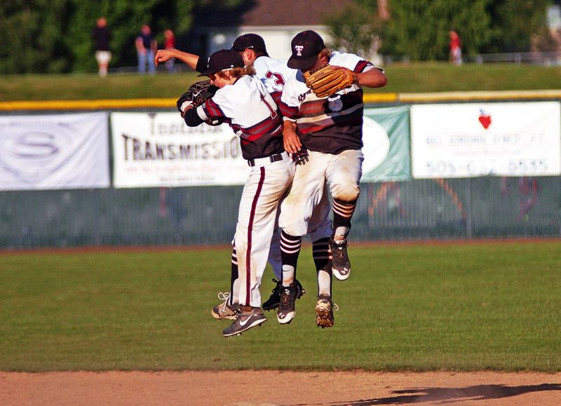 by: DAN BROOD - JUMPING FOR JOY -- Tualatin outfielders (from left) Chase Anderson, Cooper Brunner and Brandon Shroyer celebrate following the Timberwolves' state playoff quarterfinal victory over McMinnville.