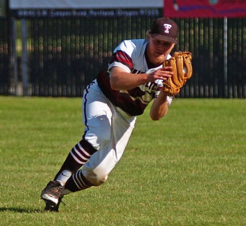 by: DAN BROOD - HE'S GOT IT -- Tualatin senior Brandon Shroyer makes the first of his two running catches in right field.