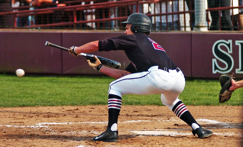 by: DAN BROOD - SMALL BALL -- Bowmen senior Keegan Lawrence looks to put down a bunt in Tuesday's state playoff semifinal game.