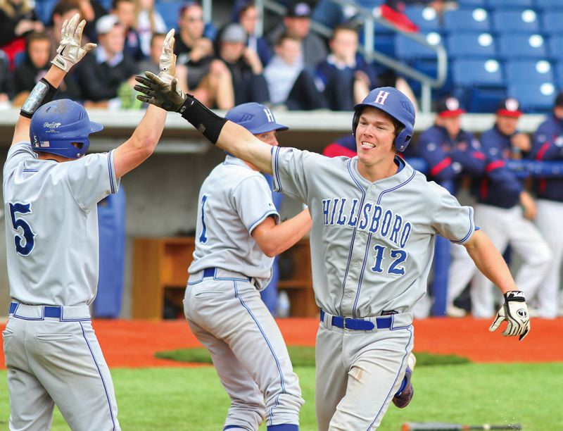 by: HILLSBORO TRIBUNE PHOTO: CHASE ALLGOOD - Hillsboro senior Chase Kaplan is congratulated by teammate Dylan Frederick (5) after Kaplan scored a run last Wednesday in the Spartans' 5-4 state playoff win over Westview.