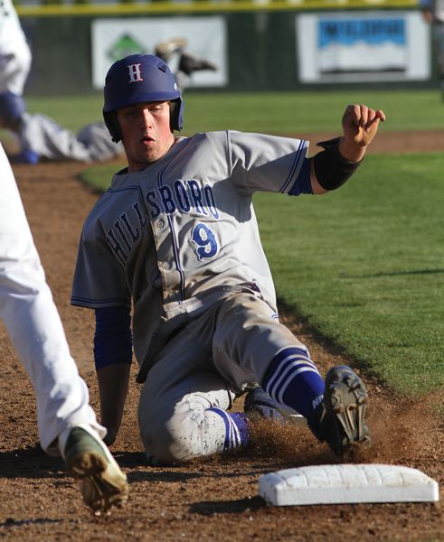 by: HILLSBORO TRIBUNE PHOTO: AMANDA MILES - Hillsboro junior Isaac Mitzel slides into third base during Tuesday's 3-1 loss to Sheldon in the semifinals of the Class 6A baseball state playoffs.