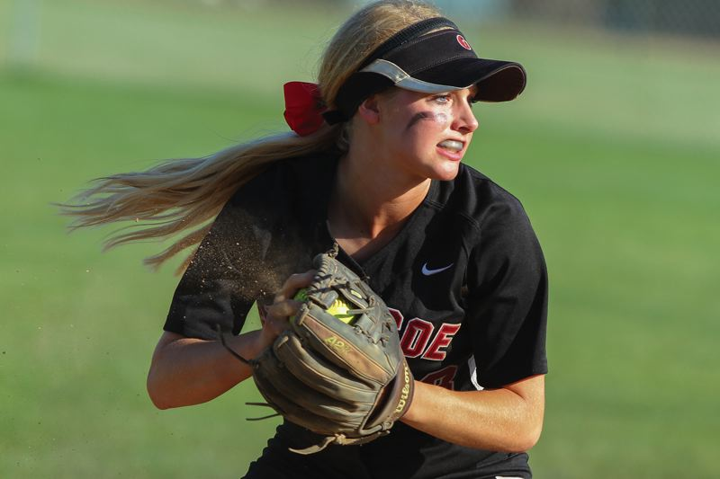by: HILLSBORO TRIBUNE PHOTO: CHASE ALLGOOD - Glencoe senior shortstop Courtney Clayton shakes the dust out of her glove as she prepares to make a throw to first base last Friday.